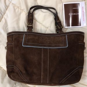 Brown suede Coach tote.